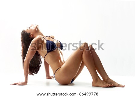 Sexy swimsuit latin woman on white background.