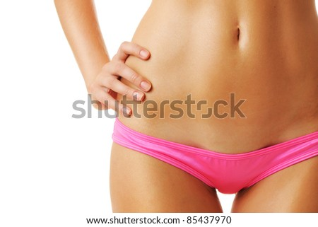 Sexy tan woman in bikini close-up isolated on white background
