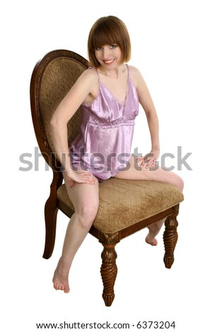 Sexy Thirty Something Woman Sitting In Chair Wearing