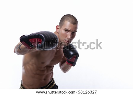 Sexy well trained male with muay thai gloves