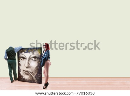 Sexy woman and man without head standing at gallery, holding  oil image and looking at blank walls around its