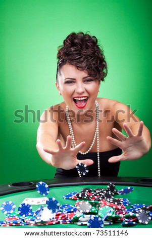 sexy woman at poker table pushing all in