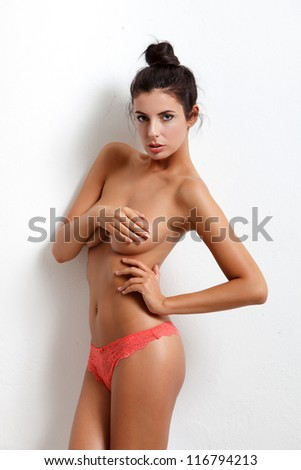 Sexy woman at white wall