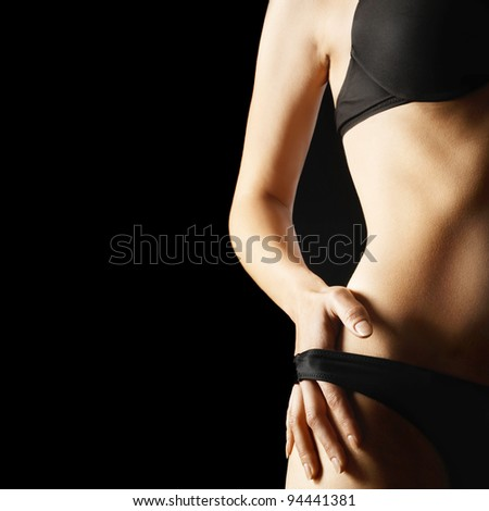 Sexy woman body lingerie isolated on black background.