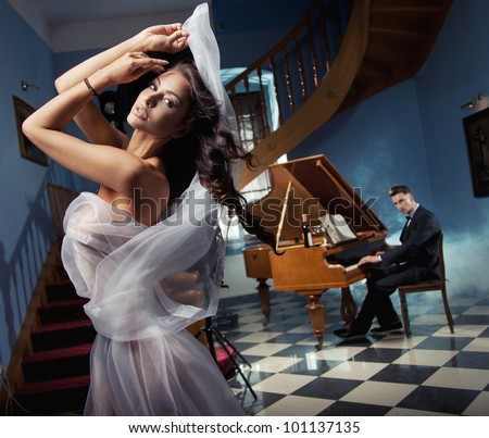 Sexy woman dancing to the piano music