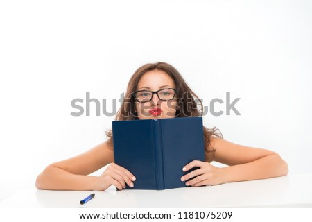 Sexy woman gives lessons of seduction. Sexy woman with book. Knowledge of seduction techniques. Lessons for the future. Seductive beauty.