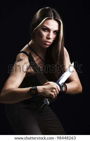 Sexy woman holding dagger