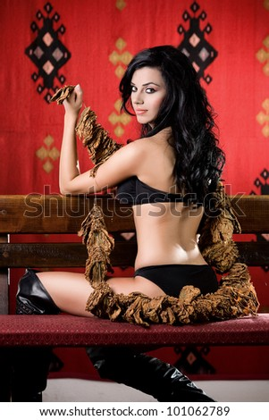 Sexy Woman holding tobacco - stock photo