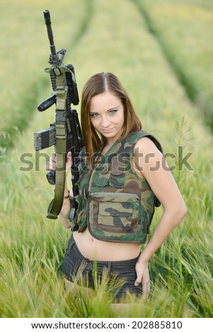 sexy woman holding up her weapon