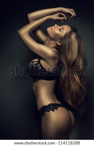 sexy woman in black lingerie with long hair