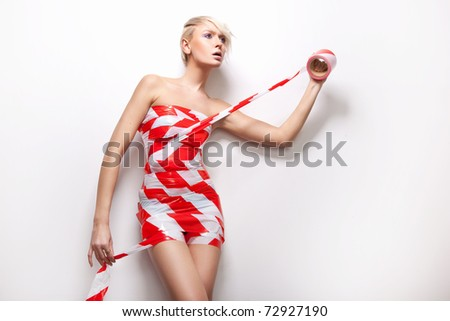 Sexy woman in dress made of tape