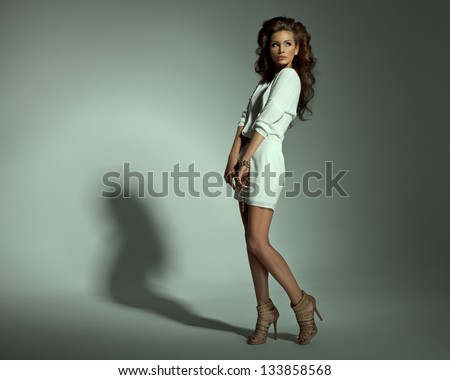 Sexy woman in dress on green background