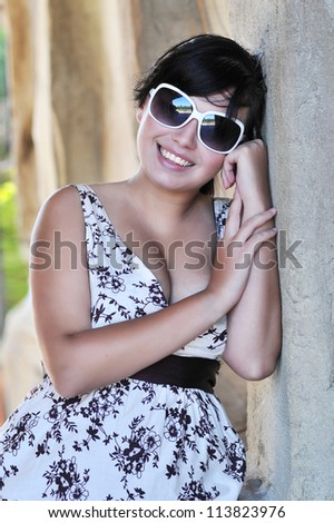 Sexy woman in dress with sunglasses