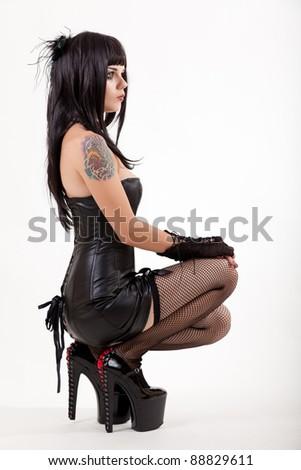 Sexy woman in mini dress, studio shot on white background