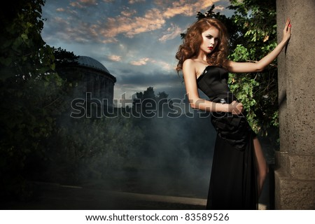 Sexy woman in stylish garden - stock photo