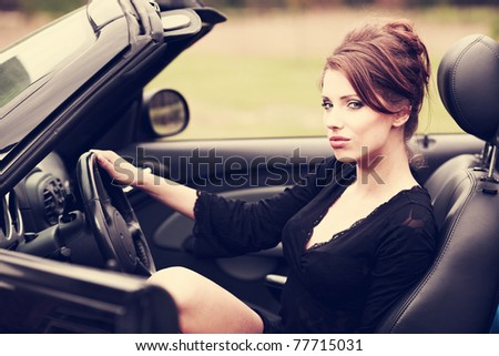 Sexy woman in the car