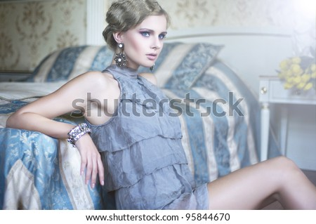 Sexy woman in the stylish room