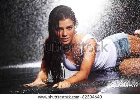 sexy woman in water studio