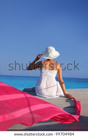Sexy Woman in white dress  relaxing against azure sea with copyspace