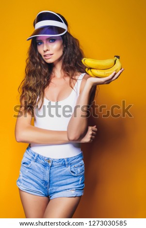 44c98716c333a ... isolated over yellow background. Sexy Woman in white swimsuit and blue  jeans shorts