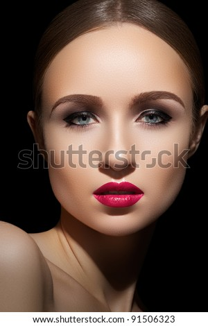 Sexy woman model with bright fuchsia lips makeup, strong eyebrows & cheekbones and healthy shiny skin. Evening glamour style, fashion make-up