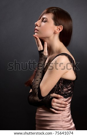 Sexy woman on a black background. Shot in a studio