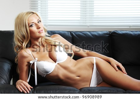 sexy woman on leather sofa