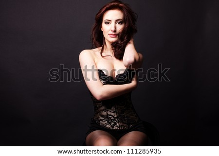 sexy woman  posing over dark background #111285935