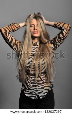 Sexy woman posing over grey background