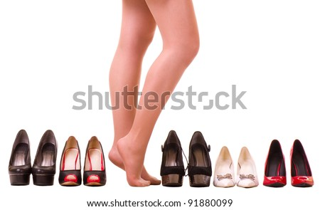 Sexy woman's legs with fashion shoes  isolated on white background.