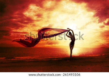 Sexy Woman Silhouette over Red Sunset Sky, Sensual Female on Beach, Vacation Holiday Concept, Girl with Windy Flying Cloth #261493106