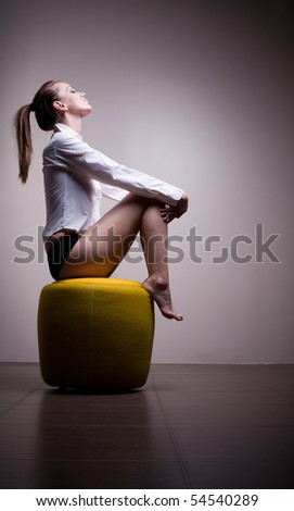 Sexy woman sitting alone in contemplation