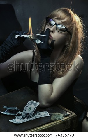 Sexy woman smoking cigarette