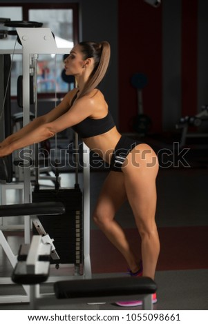 Sexy woman. Sport concept. hot sport lady with fit body training in gym. She posing and shows her sexy ass. Fat ass. Sport concept. Fit bode. Trained legs. Blur background of sport gym.