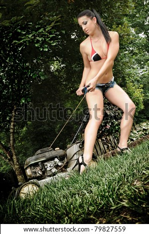stock-photo-sexy-woman-starting-a-lawn-mower-79827559.jpg