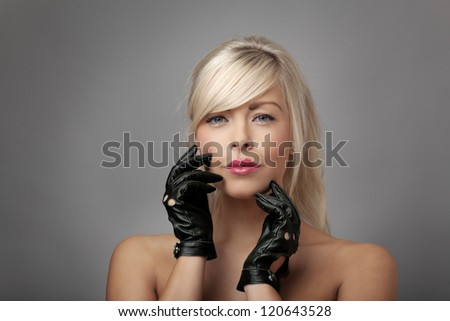 sexy woman wearing leather driving gloves