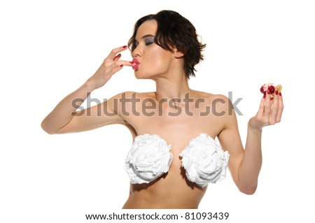 sexy woman with cream on his chest and licks his finger pastry isolated on white