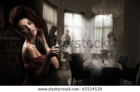 Sexy woman with cup of coffee - stock photo