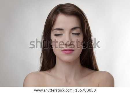 sexy woman with eyes closed facing the camera