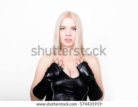 Slim sexy woman with hourglass figure in black leather