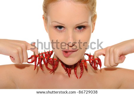 Sexy woman with jewelry of hot pepper isolated in white