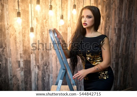 Pole dancer brunette girl hanging on the stave  Woman make a trick