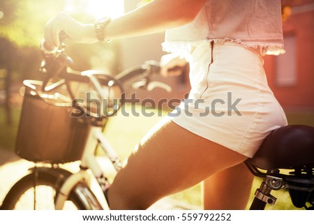 Sexy woman with perfect butt riding bicycle #559792252