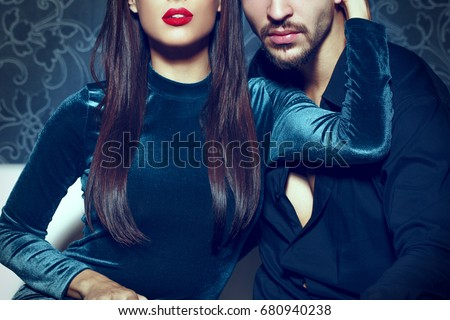 Sexy woman with red lips embrace young rich man, seduction