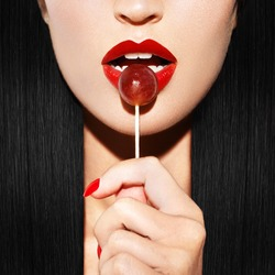Sexy woman with red lips holding lollipop, beauty closeup