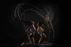 Sexy women in underwear having shower profile view