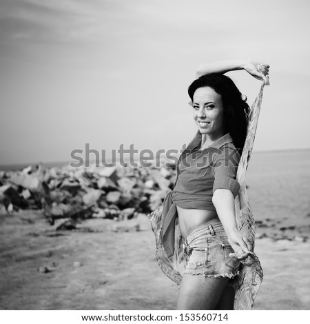 sexy young brunette by the sea, black and white