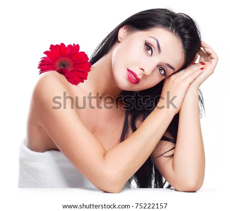 sexy young brunette woman with a red flower, isolated against white