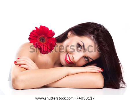 sexy young brunette woman with a red flower, isolated against white background