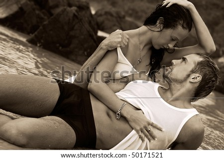 Sexy young couple on beach in underwear
